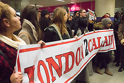 """St Pancras, London, January 16th 2016. Dozens of protesters hold an """"emergency demonstration and die-in"""" as France prepares to bulldoze the Jungle Camp at Calais. PICTURED: Protesters hold their London 2 Calais banner inside the King's Cross St Pancras tube station after finding their way into the Eurostar terminal blocked by police. ///FOR LICENCING CONTACT: paul@pauldaveycreative.co.uk TEL:+44 (0) 7966 016 296 or +44 (0) 20 8969 6875. ©2016 Paul R Davey. All rights reserved."""