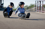 Cameron Pratt, right, leads his brother down a walkway at the Liberty High School stadium on Monday, April 7, 2008. The twin brothers, 6, played on their skateboards while their mother ran on the stadium's track. (Photo by Kevin Bartram/For The Brentwood Press)