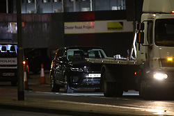 © Licensed to London News Pictures. 30/10/2019. Manchester, UK. Police close off Deansgate and surround a black Range Rover after two men are arrested on terrorism related charges . Photo credit: Joel Goodman/LNP