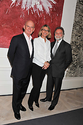 Left to right, CHRISTOPHER O'DONOGHUE, KATE PERCIVAL and DR TIM EVANS at a party to celebrate the publication of Mum's The Word by Eve Branson held at Grace, West Halkin Street, London on 11th March 2013.