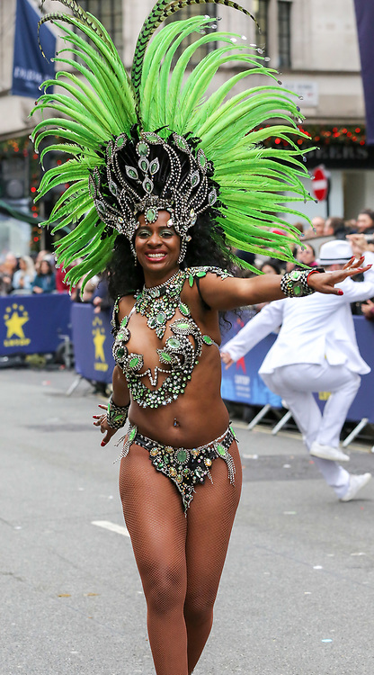 © Licensed to London News Pictures. 01/01/2019. London, UK. Dancers from the London School of Samba take part in the annual New Year's Day Parade in London. Over half a million spectators line the 2.2 mile route from Piccadilly Circus to Parliament Square as more than 8,000 performers from 26 countries participates in 33rd London's New Year's Day Parade. Photo credit: Dinendra Haria/LNP