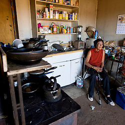 101111       Brian Leddy.Yvondra Wauneka sits in her kitchen at her home in Blue Canyon, Ariz. Tuesday. Wauneka's home is in complete disrepair is unfit for living due to numerous problems. The chapter is in the process of building a new home for Wauneka, but ran out of money and may not be able to complete it before winter.