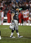 Oakland Raiders tackle Donald Penn (72) takes a drink break during the NFL week 12 regular season football game against the Kansas City Chiefs on Thursday, Nov. 20, 2014 in Oakland, Calif. The Raiders won their first game of the season 24-20. ©Paul Anthony Spinelli
