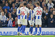Brighton and Hove Albion striker Glenn Murray (17) is congratulated by Brighton and Hove Albion midfielder Alireza Jahanbakhsh Jirandeh (16) after his goal 1-0 during the Premier League match between Brighton and Hove Albion and West Ham United at the American Express Community Stadium, Brighton and Hove, England on 5 October 2018.