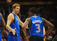 Feb. 17, 2011; Phoenix, AZ, USA; Dallas Mavericks forward Dirk Nowitzki (41) reacts on the court with teammate guard Rodrigue Beaubois (3) while playing against the Phoenix Suns at the US Airways Center. Mandatory Credit: Jennifer Stewart-US PRESSWIRE