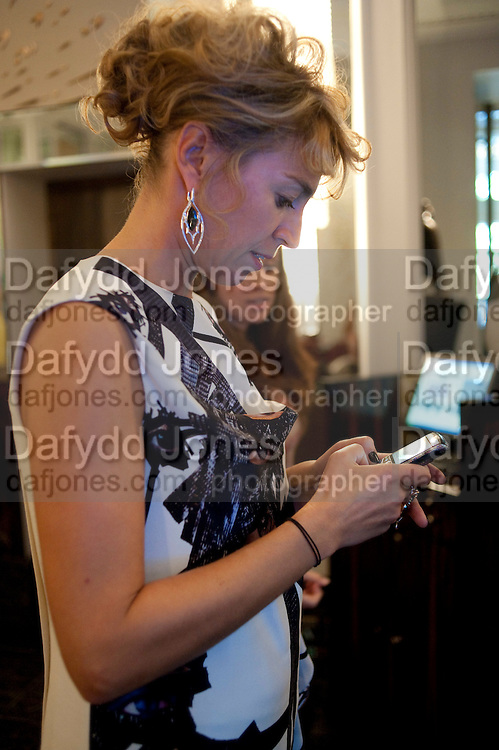 ASSIA WEBSTER, Stephen Webster hosted  the Stephen Webster Bijoux Tea.  Launching the  tea  inspired by Stephen&Otilde;s most recent fine jewellery collection &Ocirc;Murder She Wrote&Otilde; whichwas also on display. Langham Hotel. Portland Place. London. 14 September 2011. <br /> <br />  , -DO NOT ARCHIVE-&copy; Copyright Photograph by Dafydd Jones. 248 Clapham Rd. London SW9 0PZ. Tel 0207 820 0771. www.dafjones.com.<br /> ASSIA WEBSTER, Stephen Webster hosted  the Stephen Webster Bijoux Tea.  Launching the  tea  inspired by Stephen&rsquo;s most recent fine jewellery collection &lsquo;Murder She Wrote&rsquo; whichwas also on display. Langham Hotel. Portland Place. London. 14 September 2011. <br /> <br />  , -DO NOT ARCHIVE-&copy; Copyright Photograph by Dafydd Jones. 248 Clapham Rd. London SW9 0PZ. Tel 0207 820 0771. www.dafjones.com.