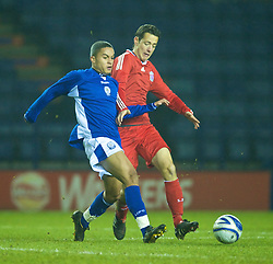 LEICESTER, ENGLAND - Tuesday, January 12, 2010: Liverpool's Krisztian Adorjan in action against Leicester City's Nathan Hicks during the FA Youth Cup 4th Round match at the Walkers Stadium. (Photo by David Rawcliffe/Propaganda)