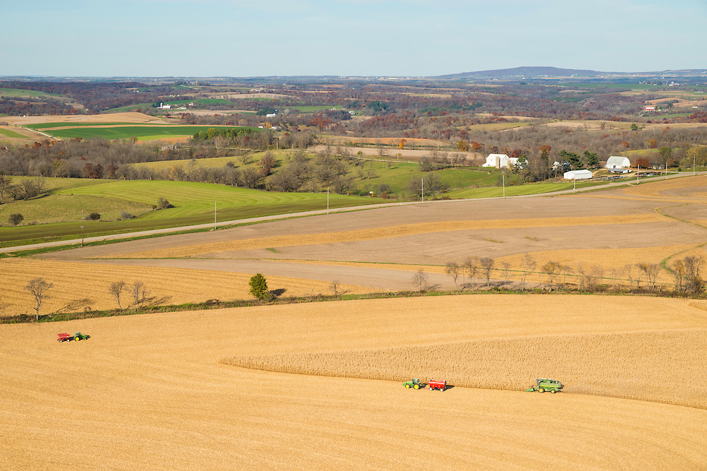 Aerial photograph of corn harvest in rural, southwest Wisconsin. Blue Mound State Park is on the horizon.