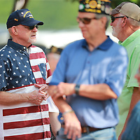 Paul Poland, left, of Guntown who served aboard the U.S.S. Brinkley Bass destroyer chats with friends before Monday's Memorial Day service gets underway.
