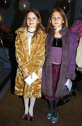 Left to right, ARIANE DE SELLIERS and POPPY WORCESTER at a performance by the London Childrens Ballet of 'The Little Princess' at The Peacock Theatre, Portugal Street, London WC2 on 19th May 2005.<br />