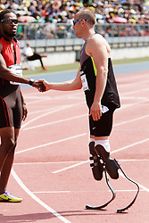 Samsung Diamond League adidas Grand Prix track & field; men's 400 meters, Oscar Pistorius, RSA, Olympic aspiring double amputee on Cheetahs, congratulate competitor Henry post race
