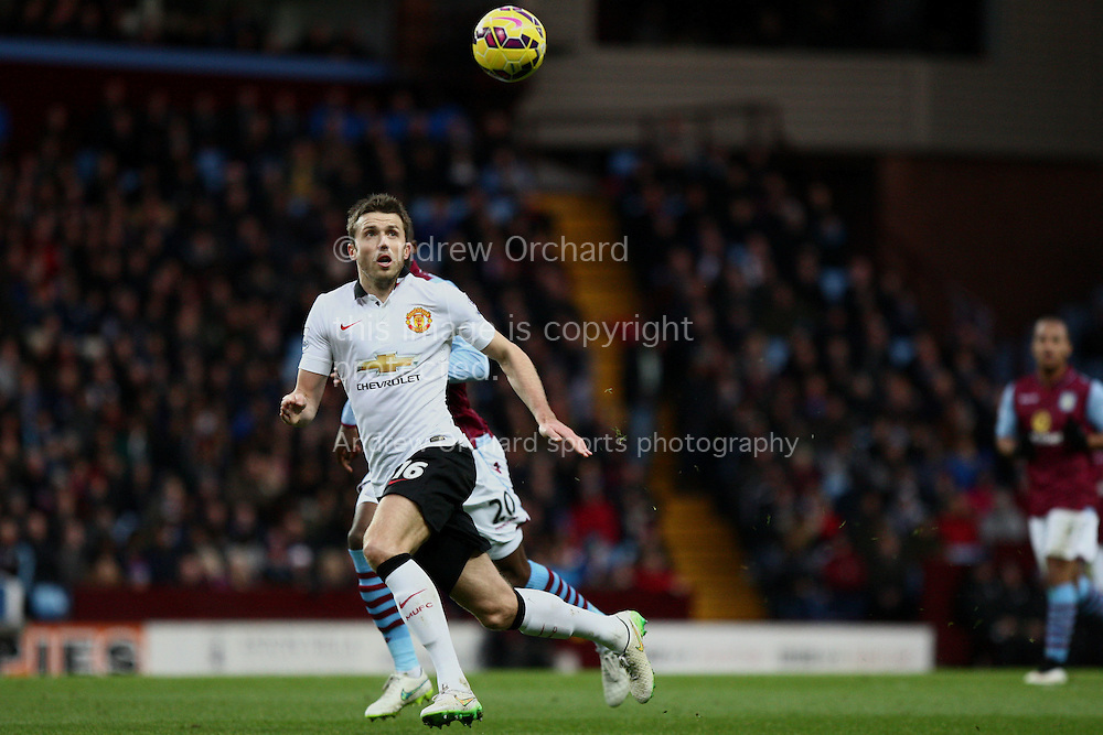 Michael Carrick of Manchester United keeps his eye on the ball. Barclays Premier league match, Aston Villa v Manchester Utd at Villa Park in Birmingham on Saturday 20th December 2014<br /> pic by Mark Hawkins, Andrew Orchard sports photography.
