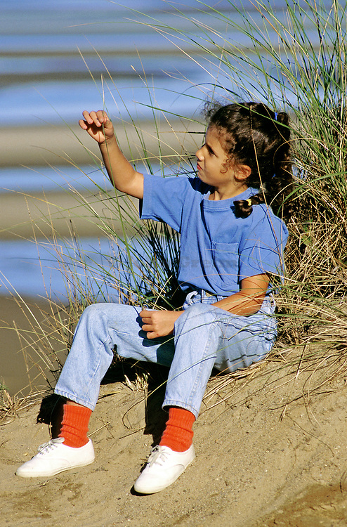 Young girl enjoys time at the beach. Eastham Massachusetts, Cape Cod.