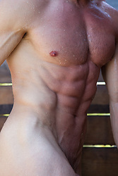nude muscular man in a shower