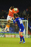 Uche Ikpeazu of Blackpool FC (On loan from Watford FC) jumps with Anthony Gerrard of Oldham Athletic during the Sky Bet League 1 match between Oldham Athletic and Blackpool at SportsDirect.Com Park, Oldham, England on 15 March 2016. Photo by Mike Sheridan.