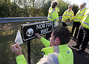© licensed to London News Pictures. CARTERTON, UK.  01/09/11. A workman renews a transfer on the street sign where the ceremony takes place. A ceremony takes place at The Memorial Garden at Norton Way in Carterton, Oxfordshire today (01 Sept 2011). The Garden will become the focal point during the repatriation of UK service personnel from RAF Brize Norton. The Union Flag that used to fly at repatriations in Wooton Bassett was handed over and was blessed. . Mandatory Credit Stephen Simpson/LNP