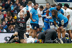 The England physio calls for a stretcher after England Full Back Mike Brown suffers a concussion - Photo mandatory by-line: Rogan Thomson/JMP - 07966 386802 - 14/02/2015 - SPORT - RUGBY UNION - London, England - Twickenham Stadium - England v Italy - 2015 RBS Six Nations Championship.