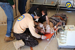 Apr 4, 2017 - Syria - In this photo from the Syria Civil Defence, also better known as the White Helmets, Volunteers in the Syria Civil Defence help victims in a a suspected chemical attack. At least 58 people have been killed, and dozens wounded , including 11 children, in the early morning attack in a suspected chemical attack on a rebel-held town in north-western Syria. (Credit Image: © Syria Civil Defence via ZUMA Wire).