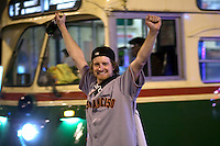 SAN FRANCISCO, CA - NOV 1: A Giants fan celebrates on Market Street after the San Francisco Giants defeated the Texas Rangers to win the World Series in 5 games on November 1, 2010 in San Francisco, California.  Photograph by David Paul Morris