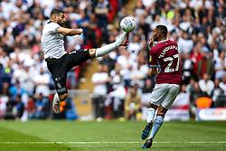 Bradley Johnson of Derby County beats Ahmed Elmohamady of Aston Villa to the ball - Mandatory by-line: Robbie Stephenson/JMP - 27/05/2019 - FOOTBALL - Wembley Stadium - London, England - Aston Villa v Derby County - Sky Bet Championship Play-off Final