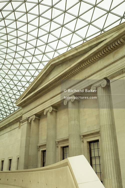 The architecture of the Great Court of the British Museum, on 28th February 2017, in London, England. Designed by Foster and Partners, the Queen Elizabeth II Great Court transformed the Museum's inner courtyard into the largest covered public square in Europe. It is a two-acre space enclosed by a spectacular glass roof with the world-famous Reading Room at its centre. The £100 million project was supported by grants of £30 million from the Millennium Commission and £15.75 million from the Heritage Lottery Fund. The Great Court was opened on 6 December 2000 by Her Majesty the Queen.
