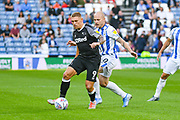 Martyn Waghorn of Derby County (9) and Aaron Mooy of Huddersfield Town (10) in action during the EFL Sky Bet Championship match between Huddersfield Town and Derby County at the John Smiths Stadium, Huddersfield, England on 5 August 2019.