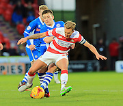 James Coppinger, Donal McDermott during the Sky Bet League 1 match between Doncaster Rovers and Rochdale at the Keepmoat Stadium, Doncaster, England on 21 November 2015. Photo by Daniel Youngs.