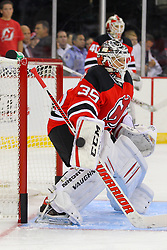 Sep 16, 2013; Newark, NJ, USA; New Jersey Devils goalie Cory Schneider (35) makes a blocker save while New Jersey Devils goalie Keith Kinkaid (40) looks on during pre-game warmups at Prudential Center.