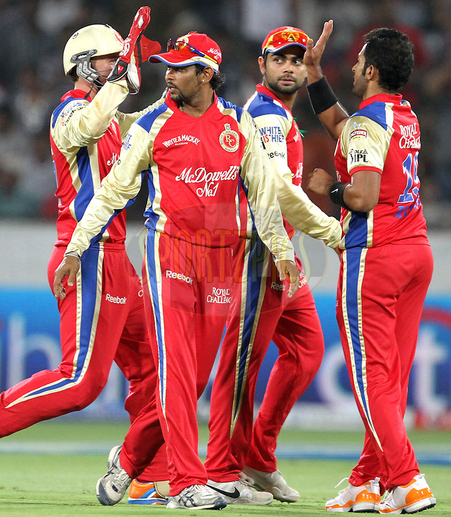 RCB celebrates DC's wicket during match 11 of the Indian Premier League ( IPL ) between the Deccan Chargers and the Royal Challengers Bangalore held at the Rajiv Gandhi International Cricket Stadium in Hyderabad on the 14th April 2011..Photo by Prashant Bhoot/BCCI/SPORTZPICS.