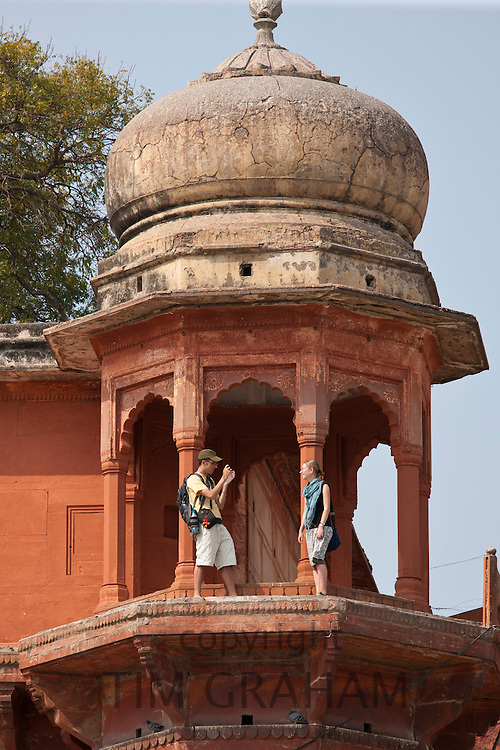 Tourists at Maharaja Chet Singh Palace Fort at Chet Singh Ghat by The Ganges River in holy city of Varanasi, Northern India