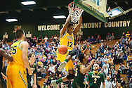 Vermont's Darren Payen (12) dunks the ball during the men's basketball game between the Lyndon State Hornets and the Vermont Catamounts at Patrick Gym on Saturday afternoon November 19, 2016 in Burlington (BRIAN JENKINS/for the FREE PRESS)