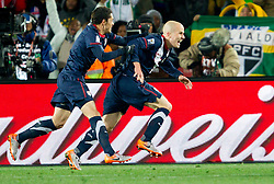 Herculez Gomez and scorer Michael Bradley celebrate after second goal for USA during the 2010 FIFA World Cup South Africa Group C match between Slovenia and USA at Ellis Park Stadium on June 18, 2010 in Johannesberg, South Africa. (Photo by Vid Ponikvar / Sportida)