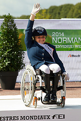 Demi Vermeulen and Vaness win bronze in the Freestyle Grade II Para Dressage - Alltech FEI World Equestrian Games™ 2014 - Normandy, France.<br /> © Hippo Foto Team - Leanjo de Koster<br /> 25/06/14