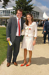 MR & MRS RICHARD HANNON JNR at the 3rd day of the Glorious Goodrwood Racing festival 2006 - Ladies Day, at Goodwood Race course, West Sussex on 3rd August 2006.<br /><br />NON EXCLUSIVE - WORLD RIGHTS
