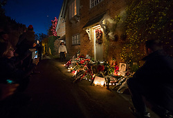 © Licensed to London News Pictures. 26/12/2016. Goring-, UK. Fans (L) take photographs of tributes to George Michael placed at the front door of his house in Goring. Pop superstar George Michael died on Christmas day at his Oxfordshire home on the River Thames aged 53. Photo credit: Peter Macdiarmid/LNP