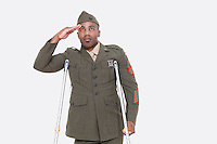 Disabled African American military officer in uniform salutes over gray background