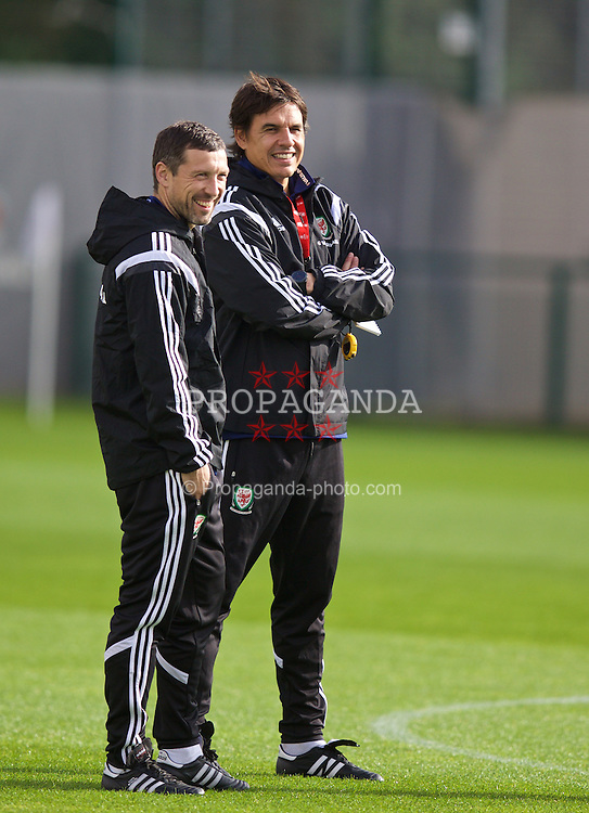 NEWPORT, WALES - Wednesday, October 8, 2014: Wales' manager Chris Coleman and head of fitness and science Ryland Morgans training at Dragon Park National Football Development Centre ahead of the UEFA Euro 2016 qualifying match against Bosnia and Herzegovina. (Pic by David Rawcliffe/Propaganda)