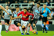 Isaac Hayden (#14) of Newcastle United wins the ball from Alexis Sanchez (#7) of Manchester United during the Premier League match between Newcastle United and Manchester United at St. James's Park, Newcastle, England on 2 January 2019.