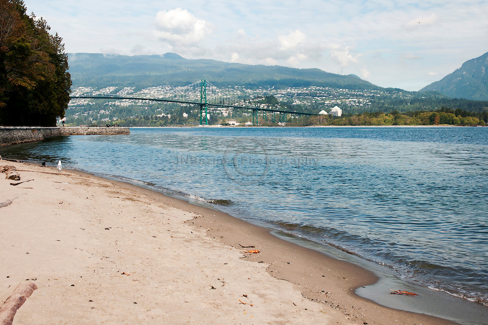 From a beach on Stanley Park the Lions Gate Bridge can be seen connecting the north and south shores of Vancouver.