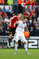 Morgan Schneiderlin of Manchester United and Gylfi Sigurdhsson of Swansea City compete in the air - Mandatory byline: Rogan Thomson/JMP - 07966 386802 - 30/08/2015 - FOOTBALL - Liberty Stadium - Swansea, Wales - Swansea City v Manchester United - Barclays Premier League.