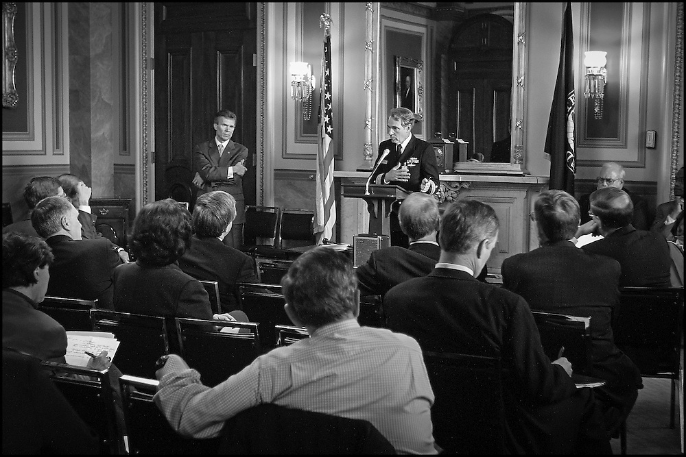 Attending Physican John Eisold briefs Senators in the LBJ Room on the current status of the Dricksen and Hart Buildings.  10/25/01..©PF BENTLEY/PFPIX.com