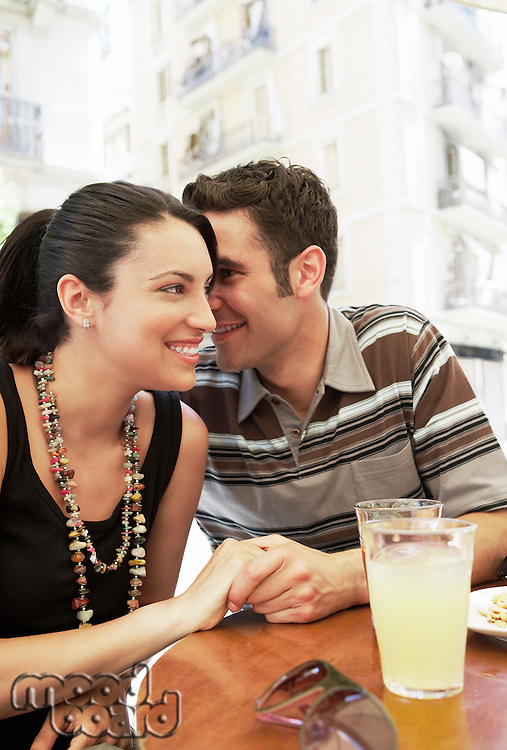 Young couple at cafe portrait