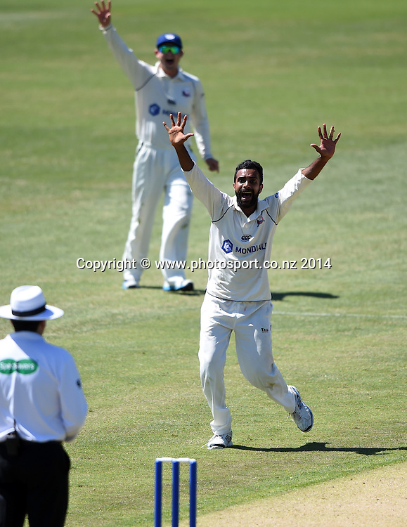 Auckland bowler Tarun Nethula appeals unsuccessfully during the Plunket Shield 4 day cricket match between Auckland Aces and Central Stags at the Eden Park Outer Oval, Auckland, New Zealand. Friday 19 December 2014. Photo: Andrew Cornaga/www.Photosport.co.nz