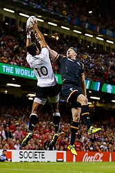 Fiji Fly-Half Ben Volavola and Wales Winger Alex Cuthbert go for a high ball - Mandatory byline: Rogan Thomson/JMP - 07966 386802 - 01/10/2015 - RUGBY UNION - Millennium Stadium - Cardiff, Wales - Wales v Fiji - Rugby World Cup 2015 Pool A.