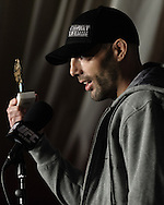 "MANCHESTER, ENGLAND, NOVEMBER 12, 2009: Mike Swick holds a ""second place"" trophy which he was given by opponent Dan Hardy (not pictured) during the pre-fight press conference for UFC 105 at the MEN Arena in Manchester, England on November 12, 2009."