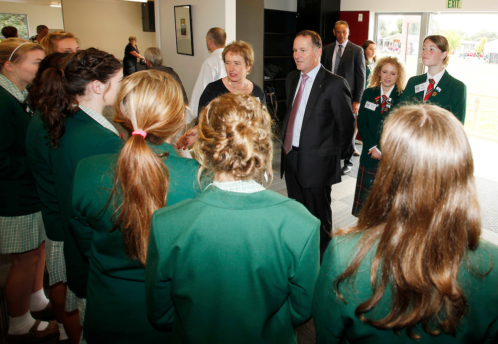 Prime Minister John Key, centre, visits Avonside Girl's High School, the school was closed due to earthquake damage and is now operating with new buildings and refurbished grounds and gardens, Christchurch, New Zealand, Thursday, February 16, 2012.  Credit:SNPA / Pam Johnson
