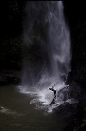 Children diving on a waterfall lake near Cerro Punta in Panama