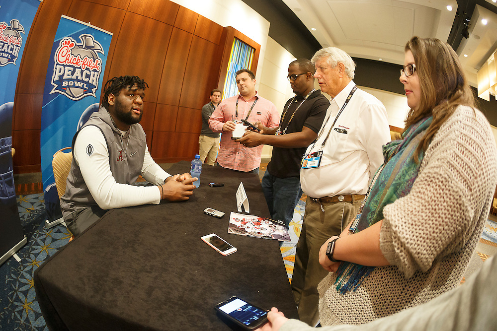 Alabama Crimson Tide coaches and players speak with members of the media on December 27, 2016 in Atlanta. Alabama faces the Washington Huskies in the 2016 Chick-fil-A Peach Bowl Playoff Semifinal on New Year's Eve, with the winner advancing to the National Championship. (Paul Abell / Abell Images for the Chick-fil-A Peach Bowl)