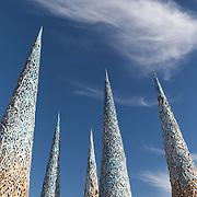 Subterrafuge spires with cloud at AfrikaBurn 2014, Tankwa Karoo desert, South Africa. The art installation is a comment against fracking in the Karoo desert.