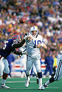 ORCHARD PARK, NY - JANUARY 2: Peyton Manning #18 of the Indianapolis Colts passes the football against the Buffalo Bills at Ralph Wilson Stadium on January 2, 2000 in Orchard Park, New York. The Bills defeated the Colts 31-6. (Photo by Joe Robbins) *** Local Caption *** Peyton Manning